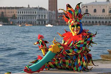 Harlequin, Carnival in Venice, background Doge's Palace, Venice, Italy, Europe