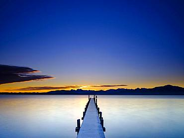 Footbridge at Chiemsee at sunrise, behind the Chiemgau Alps, Chiemgau, Upper Bavaria, Bavaria, Germany, Europe