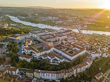 Aerial view of Coimbra with university at top of the hill at sunset, Portugal, Europe