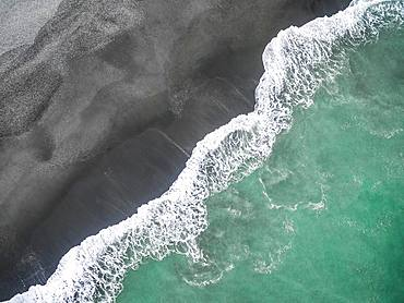 Waves on the beach, turquoise sea and black sand beach, aerial view, west coast, south island, New Zealand, Oceania