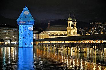 Wassertum with light installation, right Chapel Bridge, behind Jesuit Church on the Reuss at dusk, Old Town, Lilu, Light Festival 2020, Lucerne, Canton Lucerne, Switzerland, Europe