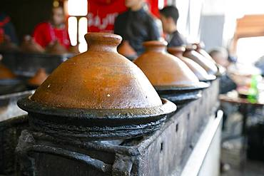 Delicious moroccan tajine prepared and served in clay pots, Marrakech, Morocco, Africa