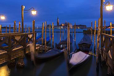 Nocturnal atmosphere with moving gondolas, San Georgio Maggiore in the back, Guidecca Island on the right, Venice, Italy, Europe