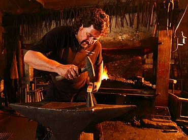 Blacksmith at the anvil, hammer mill Burghausen, Upper Bavaria, Bavaria, Germany, Europe