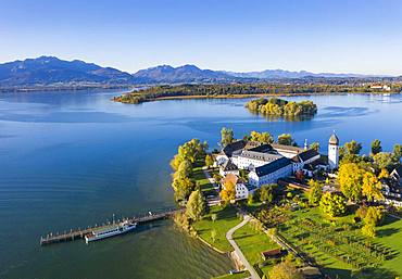 Steam jetty and Benedictine monastery Frauenwoerth on Fraueninsel, Frauenchiemsee, behind Krautinsel and Herreninsel, Chiemsee, Alps, Chiemgau, aerial view, foothills of the Alps, Upper Bavaria, Bavaria, Germany, Europe