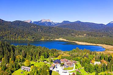 Lake Barmsee with alpine inn near Kruen, mountains Bischof and Krottenkopf in the Ester Mountains, Werdenfelser Land, drone shot, Upper Bavaria, Bavaria, Germany, Europe