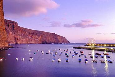 Fishing boats in the fishing port at dusk, Vueltas, Valle Gran Rey, La Gomera, Canary Islands, Spain, Europe