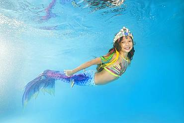 Girl in mermaid costume posing under water, Ukraine, Europe