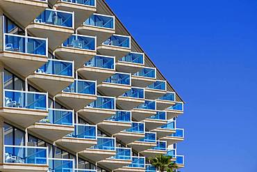 Balconies with blue glass railings at Hotel Cactus, El Albir, l'Alfas del Pi, Alicante, Spain, Europe