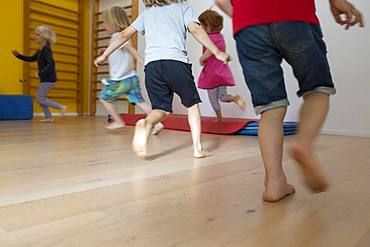 Children run, romp barefoot in kindergarten, Cologne, North Rhine-Westphalia, Germany, Europe