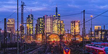 Train and tracks in front of main station and skyline Frankfurt Main in the evening, Gutleutviertel, Frankfurt, Hesse, Germany, Europe