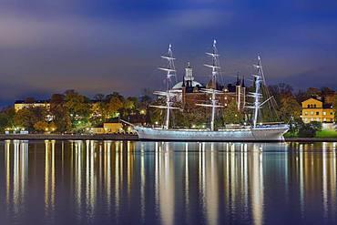 Harbour Chapman off Skeppsholmen, red admiralty house, illuminated, Stockholm, Sweden, Europe