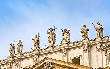 Statues of Jesus Christ, John the Baptist and Apostles on the facade of St Peter's Basilica, Piazza San Pietro, Vatican, Rome, Italy, Europe