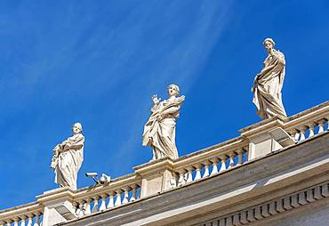 Statues of Saints Balbina, St. Lucy and St. Olympias on Bernini colonnades, St. Peter's Square, Vatican, Rome, Italy, Europe