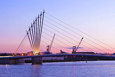 Media City footbridge and victorian cranes in afterglow, Salford Quays, Manchester, UK