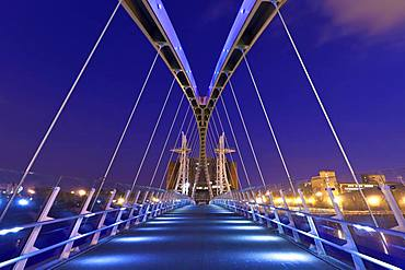 The Lowry bridge during blue hour, Salford Quays, Manchester, England, United Kingdom, Europe