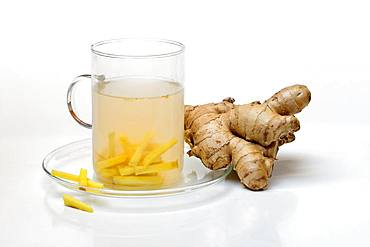 Ginger tea in glass and ginger root, Germany, Europe
