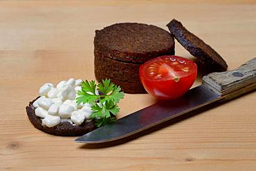 Pumpernickel disc covered with cream cheese, Germany, Europe