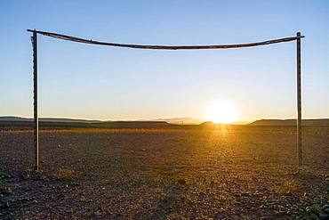 Wooden simple soccer goals on the desert at sunset, Morocco, Africa