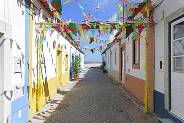 Narrow village Street decorated with flags in the old city of Alcochete, Setubal Province, Portugal, Europe