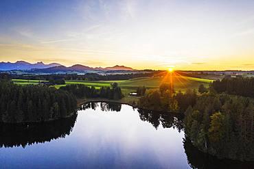 Sunset at the Schmutterweiher pond, near Rosshaupten, drone shot, Ostallgaeu, Allgaeu, Alpine foreland, Swabia, Bavaria, Germany, Europe