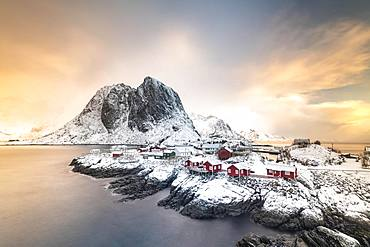 Rorbuer fishermen's cabins by the snowy fjord, Hamnoya, Moskenesoy, Lofoten, Norway, Europe
