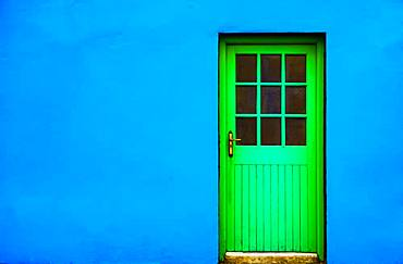 Blue house facade with green front door, Burren, West Coast, County Clare, Republic of Ireland