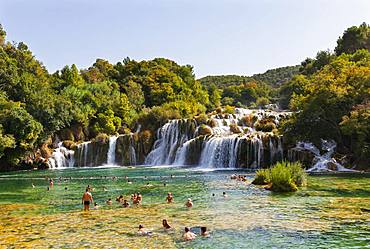 Tourists bathing at the Skradinski Buk waterfall, Krka National Park, Sibenik-Knees Region, Dalmatia, Croatia, Europe