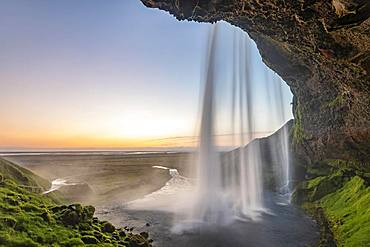 Waterfall Seljalandsfoss at sunset, Southern Iceland, Iceland, Europe