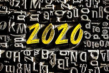 Old lead letters with golden writing show the word 2020, Germany, Europe
