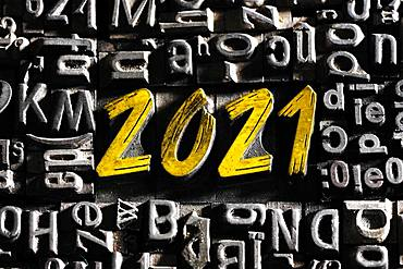 Old lead letters with golden writing show the word 2021, Germany, Europe