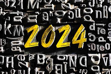 Old lead letters with golden writing show the word 2024, Germany, Europe