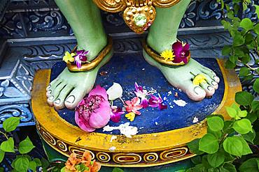 Lotus flowers are laid at the feet of the god Krishna, Shri Krishnan Hindu temple, Bugis, Singapore, Asia
