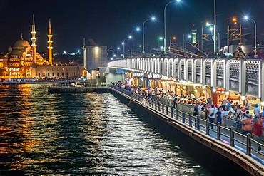 The new mosque and the Galata Bridge in Eminoenue district at night, Istanbul, Turkey, Asia