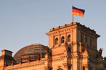 German flag on the Reichstag, in the first morning light, Berlin-Mitte, Berlin, Germany, Europe