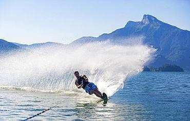 Man drives water ski, monoski, Mondsee, Salzkammergut, Upper Austria, Austria, Europe
