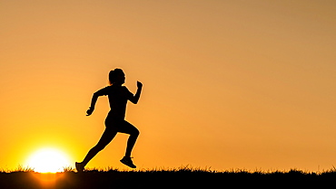Silhouette, woman, 23 years jogging, sunset, Germany, Europe