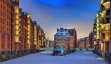 Castle in the Speicherstadt with snow in winter, evening mood, Hamburg, Germany, Europe
