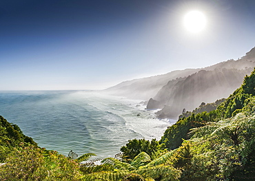 View from the coastal road, unspoiled rocky coast with sea spray, West Coast, Punakaiki, West Coast Region, New Zealand, Oceania