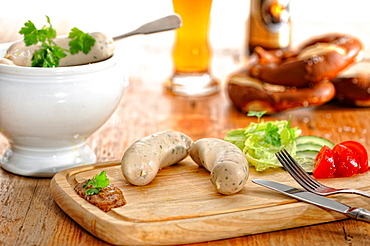Munich Weisswurst breakfast with pretzels and wheat beer, Germany, Europe