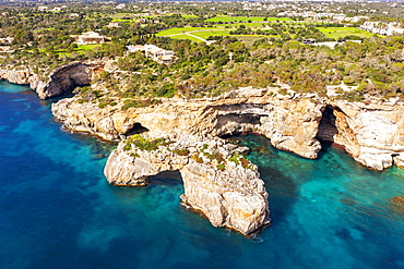 Steep coast with rock gate Es Pontas in the sea, near Cala Santayi, near Santanyi, Migjorn region, drone shot, Majorca, Balearic Islands, Spain, Europe