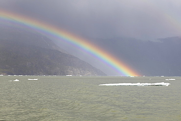 Rainbow over Caleta Tortel, Aysen Region, Patagonia, Chile, South America