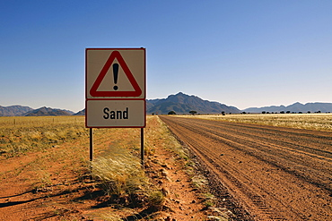Road sign warns of sand, Namibia, Africa