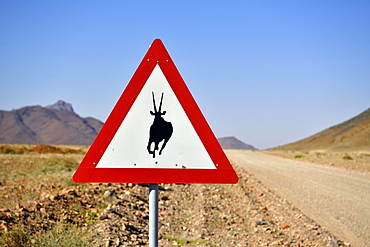 Road sign warns of crossing Oryx antelopes, Namibia, Africa