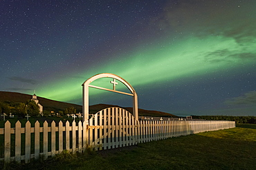 Northern lights over church and cemetery, Hvammstangi, Westfjords, Northwest Iceland, Iceland, Europe