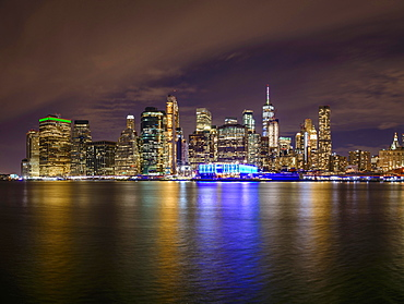 View from Pier 1 at night over the East River to the skyline of lower Manhattan, Dumbo, Downtown Brooklyn, Brooklyn, New York, USA, North America