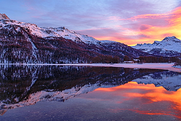 Evening mood at the Lake Silvaplana, behind snow-covered Piz da la Margna, St. Moritz, Canton Graubuenden, Switzerland, Europe