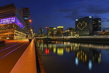 Hotel Hyatt Regency, illuminated with heart, reflection of the lights in the Rhine, closed during the Corona Pandemic, dusk, Media Harbour, Duesseldorf, North Rhine-Westphalia, Germany, Europe
