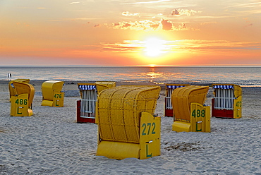 Yellow beach chairs at sunset on the beach of Cuxhaven-Doese, Lower Saxony, Germany, Europe