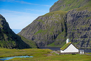 Small church with grass roof in mountain landscape, Saksun, Streymoy, Faroe Islands, Foroyar, Denmark, Europe